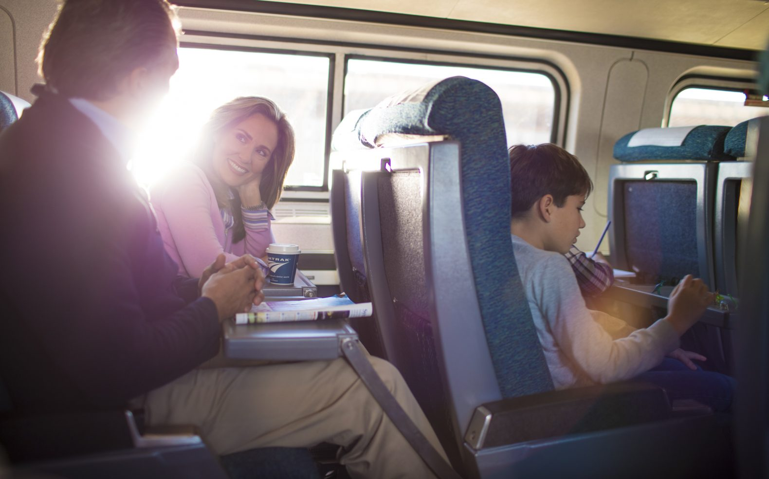 Professional photograph of family enjoying a ride on an Amtrak train on a sunny day