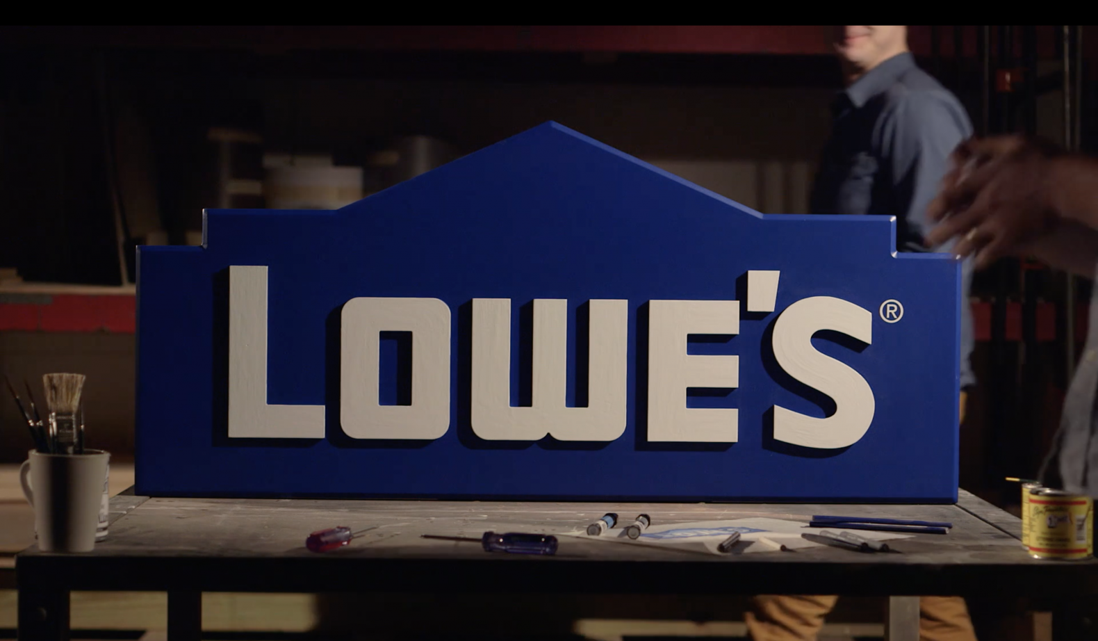 Video thumbnail image for Lowe's commercial with Lowe's logo on a drafting table.